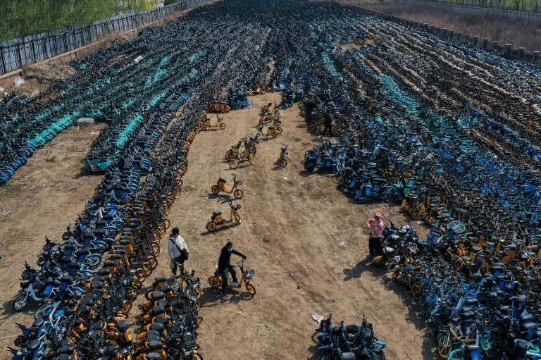 Damaged or abandoned low-cost shared bikes in China often end up in 'graveyards' like this one
