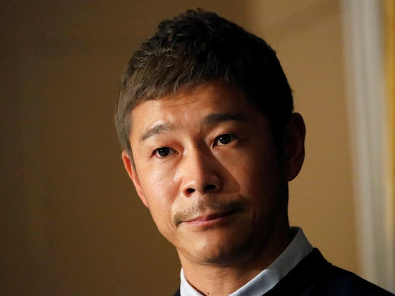 FILE PHOTO: Japanese billionaire Yusaku Maezawa, founder and chief executive of online fashion retailer Zozo, who has been chosen as the first private passenger by SpaceX, attends a news conference at the Foreign Correspondents' Club of Japan in Tokyo, Japan, October 9, 2018. REUTERS/Toru Hanai