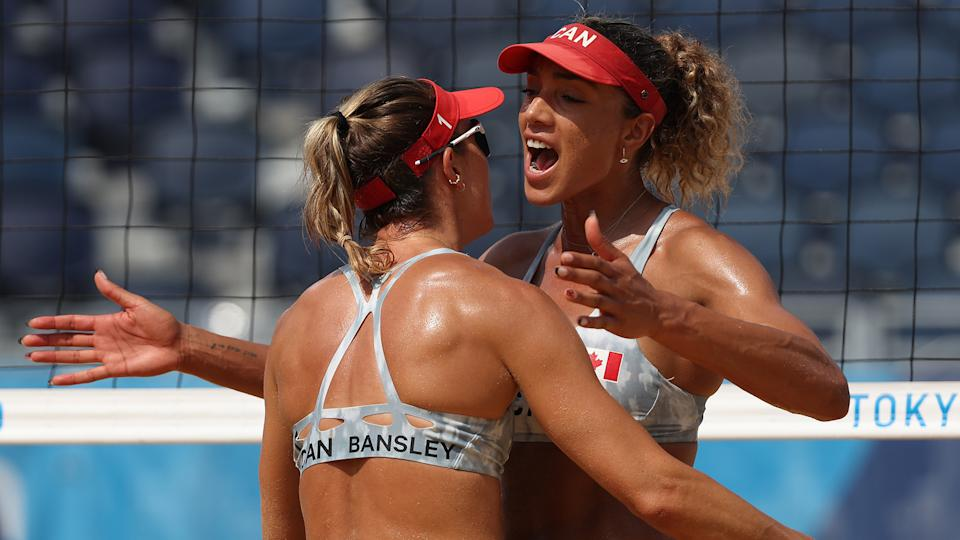 TOKYO, JAPAN - AUGUST 01: Heather Bansley #1 of Team Canada celebrates with Brandie Wilkerson #2 against Team United States during the Women's Round of 16 beach volleyball on day nine of the Tokyo 2020 Olympic Games at Shiokaze Park on August 01, 2021 in Tokyo, Japan. (Photo by Sean M. Haffey/Getty Images)
