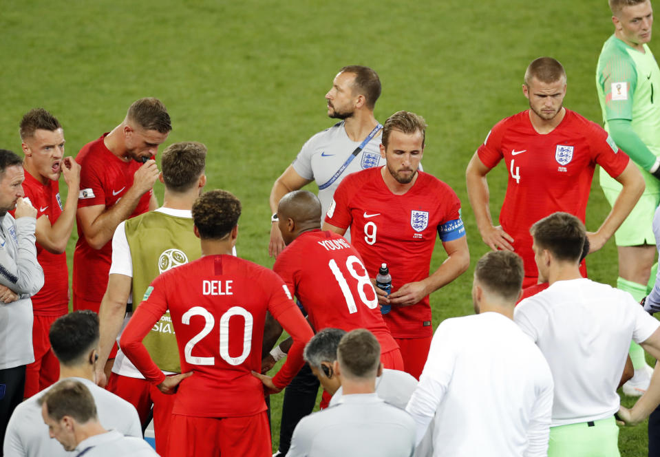 <p>On to extra time: England players get their orders from the Three Lions' management </p>