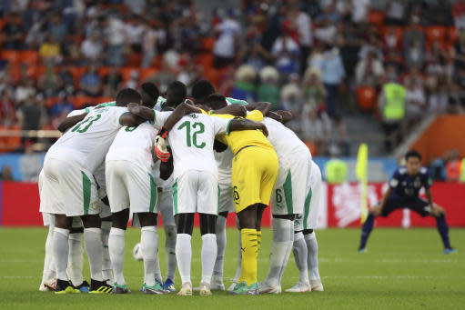 Senegal players gather at the pitch before the start of the second half of the group H match between Japan and Senegal at the 2018 soccer World Cup at the Yekaterinburg Arena in Yekaterinburg , Russia, Sunday, June 24, 2018. (AP Photo/Eugene Hoshiko)