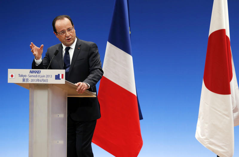 French President Francois Hollande delivers a speech during his lecture in Tokyo, Saturday, June 8, 2013. Hollande sought reassure Japanese business leaders that the eurozone debt crisis is over and that Europe is developing tools to ensure the stability and solidarity of the 17-nation group. (AP Photo/Koji Sasahara)
