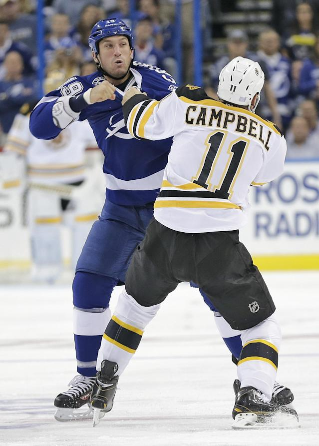 Tampa Bay Lightning right wing B.J. Crombeen (19) fights with Boston Bruins center Gregory Campbell (11) during the first period of an NHL hockey game Saturday, Oct. 19, 2013, in Tampa, Fla. (AP Photo/Chris O'Meara)