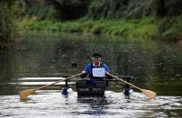 """80-year old military veteran Stanley rows homemade boat named the """"Tintanic"""" to raise funds for charity St Wilfrid's Hospice, in Chichester"""