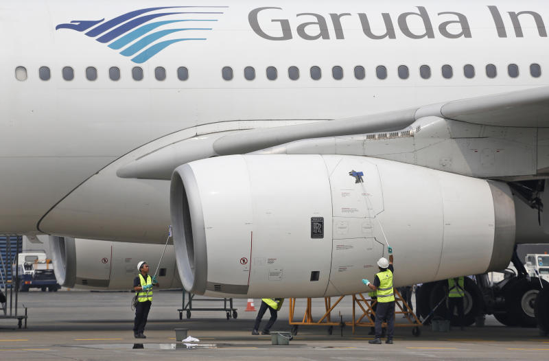 <p> FILE - In this Sept. 28, 2015, file photo, workers clean a jetliner at GMF AeroAsia facility at Soekarno-Hatta International Airport in Jakarta, Indonesia. Indonesia's flag carrier is seeking the cancellation of a multibillion-dollar order for 49 Boeing 737 Max 8 jets, citing a loss of confidence in the model following two crashes in the space of a few months. (AP Photo/Dita Alangkara, File) </p>
