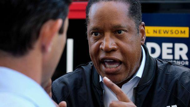 PHOTO: Republican conservative radio show host Larry Elder argues with a TV reporter during an interview after visiting a deli during a campaign for the California gubernatorial recall election on Monday, Sept. 13, 2021, in Los Angeles. (Ringo H.W. Chiu/AP)