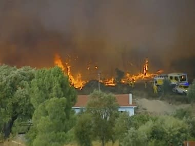 Over 1,000 firefighters, planes, helicopters battle wildfires in Portugal's Castelo Branco region; one civilian seriously injured