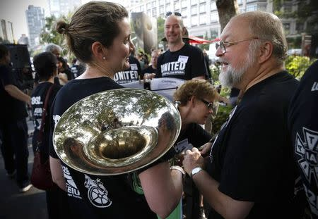 Union orchestra musicians and chorus members of New York's Metropolitan Opera gather at a rally near Lincoln Center in New York City