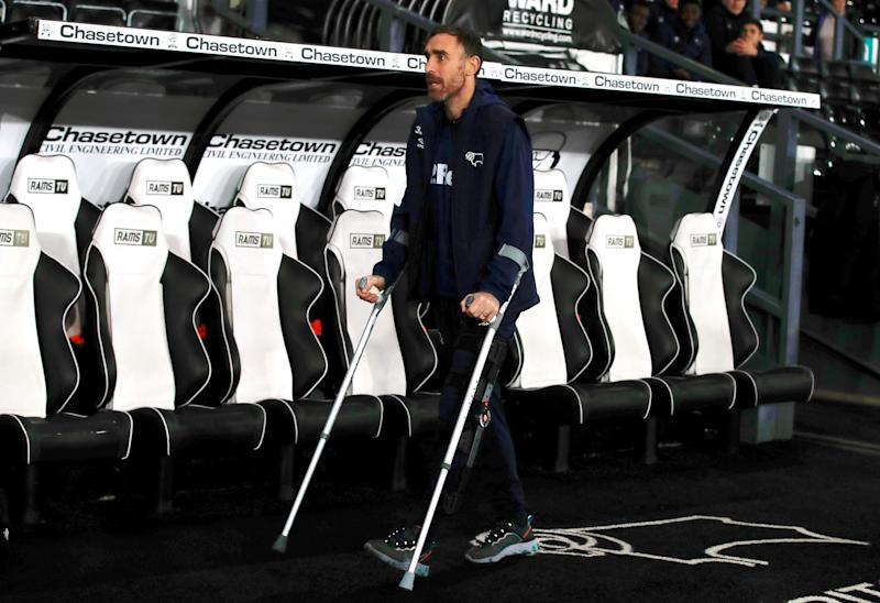 Keogh appearing in support of his Derby teammates, a month on from the crash, at the club's home game against Wigan on Oct 23 (PA)
