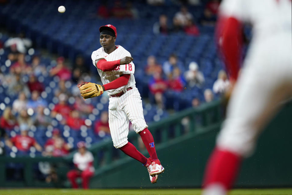 Philadelphia Phillies shortstop Didi Gregorius throws to first base after fielding a grounder by Baltimore Orioles' Kelvin Gutierrez during the sixth inning of an interleague baseball game, Tuesday, Sept. 21, 2021, in Philadelphia. Gutierrez was safe at first on a throwing error by Gregorius. (AP Photo/Matt Slocum)