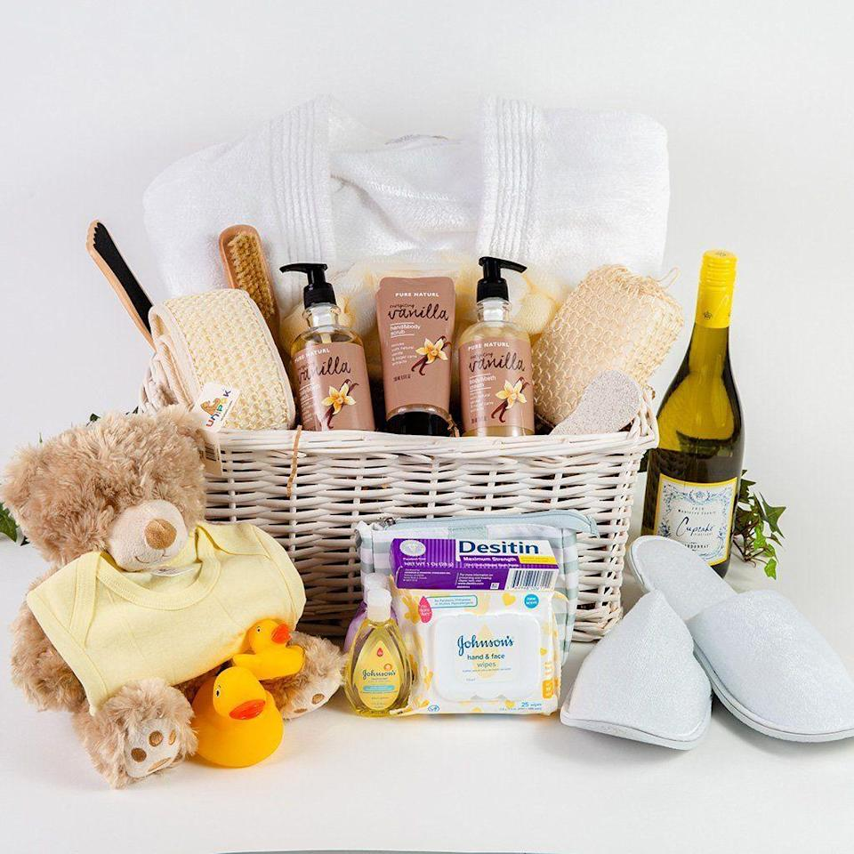 """<p><strong>GiftBasket.com</strong></p><p>giftbasket.com</p><p><strong>$130.99</strong></p><p><a href=""""https://go.redirectingat.com?id=74968X1596630&url=https%3A%2F%2Fgiftbasket.com%2Fproducts%2Fmommy-baby-bath-wine-gift-basket%3Fvariant%3D37403235549377%26gclid%3DCjwKCAjw95yJBhAgEiwAmRrutMSa_gamomYvSbOx3fS9Au3tDR7-SMDHChz4g_XIpvABB202QgZ_8hoCHnoQAvD_BwE&sref=https%3A%2F%2Fwww.cosmopolitan.com%2Fstyle-beauty%2Ffashion%2Fg37405085%2Fbest-gift-baskets-for-new-moms%2F"""" rel=""""nofollow noopener"""" target=""""_blank"""" data-ylk=""""slk:Shop Now"""" class=""""link rapid-noclick-resp"""">Shop Now</a></p><p>A basket for mama and baby filled with vino and care supplies will have her sooo giddy! </p>"""