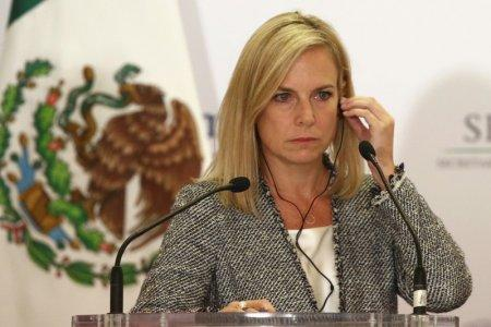 U.S. Homeland Security Secretary Kirstjen Nielsen adjusts her headset as she delivers a joint message with Mexico's Interior Minister Alfonso Navarrete Prida (not pictured) in Mexico City, Mexico March 26, 2018. REUTERS/Edgard Garrido