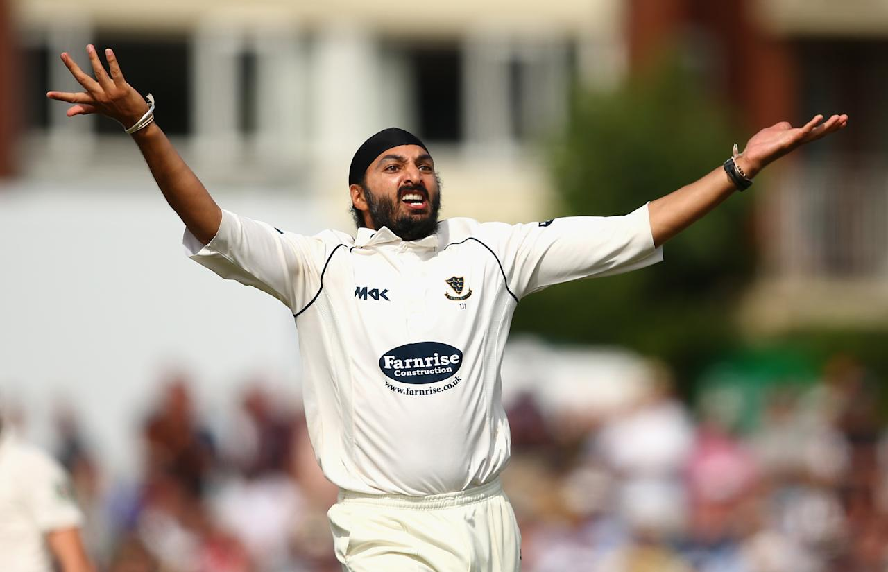 HOVE, ENGLAND - JULY 26:  Monty Panesar of Sussex celebrates after taking the wicket of Matthew Wade of Australia during Day One of the Tour Match between Sussex and Australia at The County Ground on July 26, 2013 in Hove, England.  (Photo by Ryan Pierse/Getty Images)
