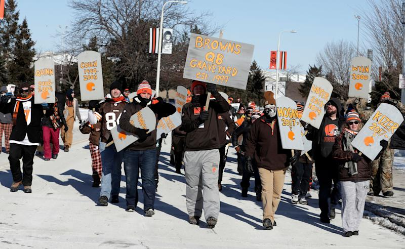 "Cleveland Browns fans hold up gravestones with names of Browns quarterbacks during the ""Perfect Season"" parade, Saturday, Jan. 6, 2018, in Cleveland. The Browns became the second team in NFL history to lose 16 games in a season. In joining the 2008 Detroit Lions in a shameful loser's club, the Browns have found a new low in what has been nearly two decades of disgrace since returning as an expansion franchise in 1999. (AP Photo/Tony Dejak)"