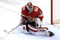 Florida Panthers goaltender Chris Driedger (60) stops the puck during the first period of an NHL hockey game against the Dallas Stars, Monday, Feb. 22, 2021, in Sunrise, Fla. (AP Photo/Lynne Sladky)