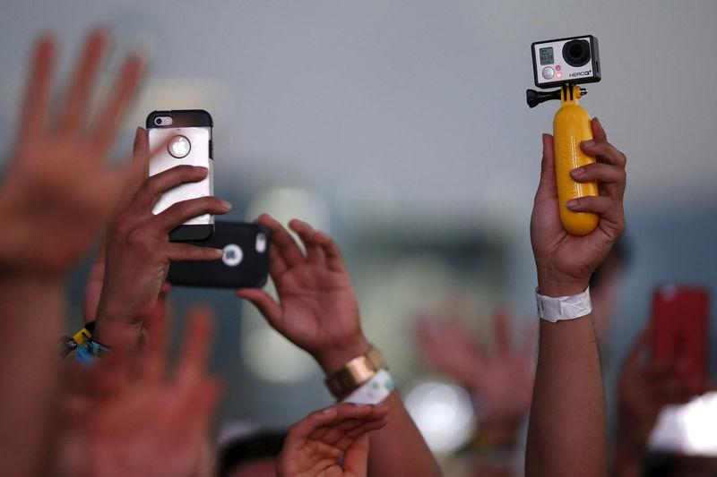 FILE PHOTO: Fans record DJ Kaskade with iPhones and a GoPro camera at the Coachella Valley Music and Arts Festival in Indio