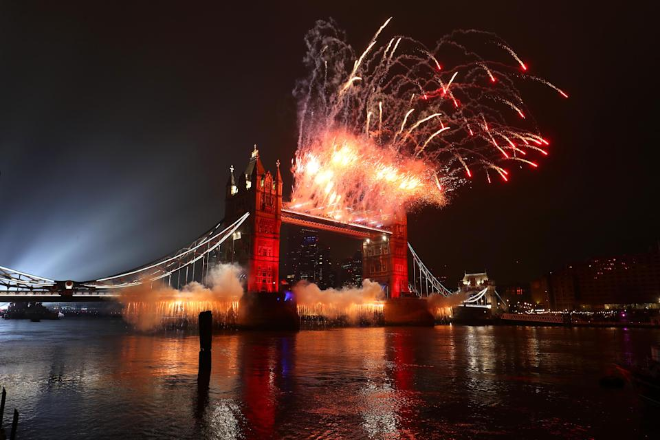 A light display over the River Thames and fireworks on Tower Bridge in London, as London's normal New Year's Eve fireworks display was cancelled due to the coronavirus pandemic.