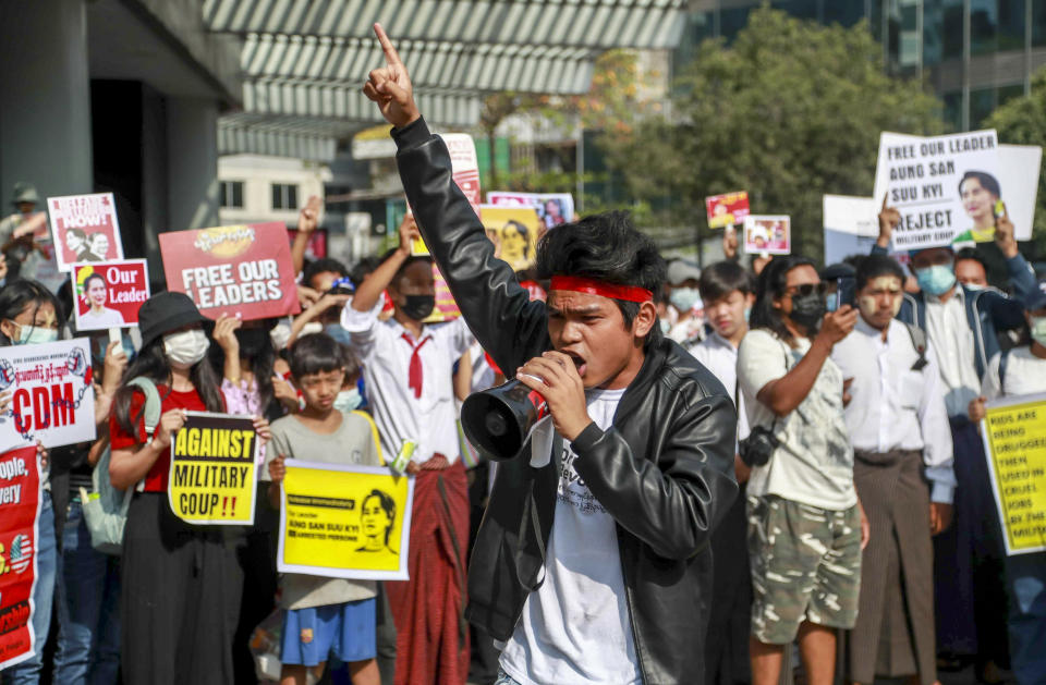 An anti-coup protester shouts slogans in Yangon, Myanmar Thursday, Feb. 25, 2021. Social media giant Facebook announced Thursday it was banning all accounts linked to Myanmar's military as well as ads from military-controlled companies in the wake of the army's seizure of power on Feb. 1.(AP Photo)