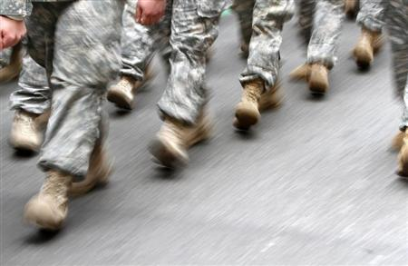 US army soldiers are seen marching in the St. Patrick's Day Parade in New York