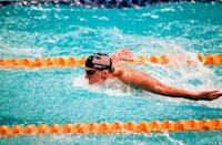 """<p>Before even stepping into the pool at the Sydney 2000 Summer Olympics, Phelps broke a world record. When he qualified for the Olympics <a href=""""https://www.britannica.com/biography/Michael-Phelps"""" rel=""""nofollow noopener"""" target=""""_blank"""" data-ylk=""""slk:at the age of 15"""" class=""""link rapid-noclick-resp"""">at the age of 15</a>, he became the youngest American male to make the swimming team in 68 years.</p>"""