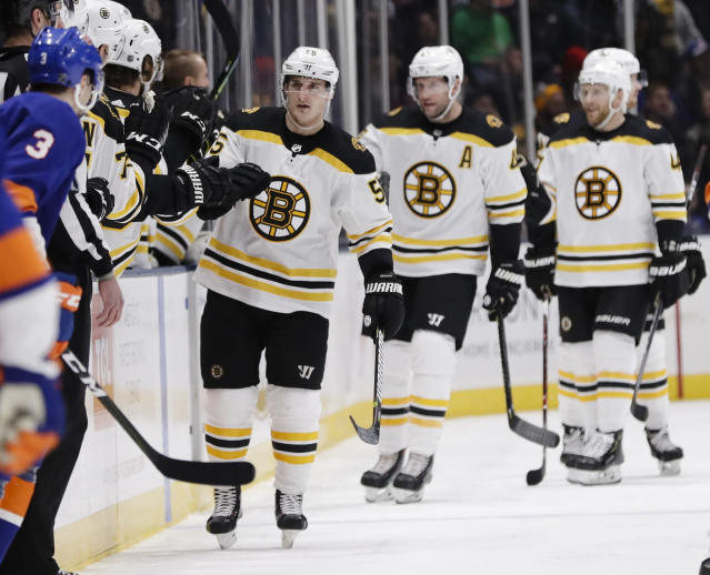 Boston Bruins' Noel Acciari celebrates with teammates after scoring a goal during the second period of an NHL hockey game against the New York Islanders Tuesday, March 19, 2019, in Uniondale, N.Y. (AP Photo/Frank Franklin II)