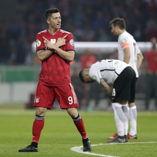 Bayern's Robert Lewandowski celebrates after scoring his side's opening goal during the German soccer cup final match between FC Bayern Munich and Eintracht Frankfurt in Berlin, Germany, Saturday, May 19, 2018. (AP Photo/Michael Sohn)