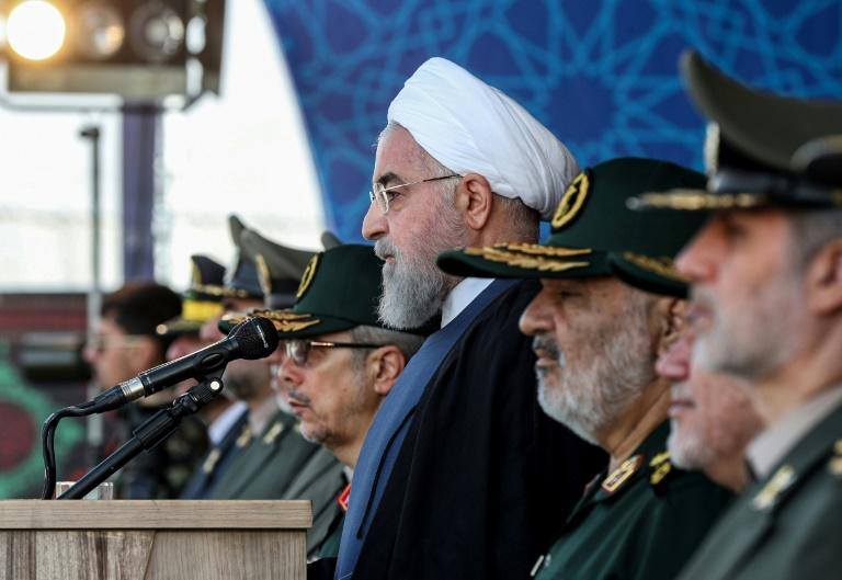 President Hassan Rouhani said at an annual military parade that Iran would put foward a peace plan to the United Nations (AFP Photo/-)