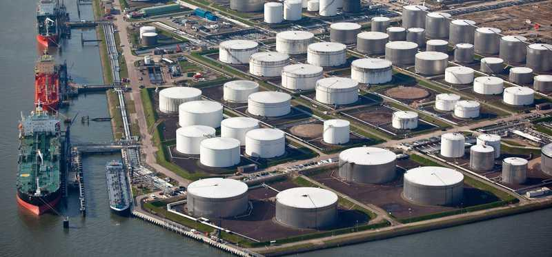 An aerial view of an oil terminal in a harbor.