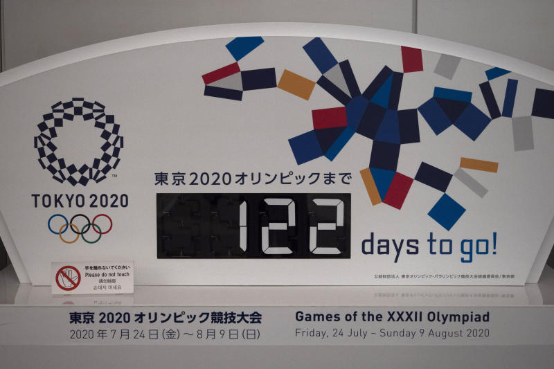 "A countdown display for the Tokyo 2020 Olympics is photographed in Tokyo, Tuesday, March 24, 2020. IOC President Thomas Bach has agreed ""100%"" to a proposal of postponing the Tokyo Olympics for about one year until 2021 because of the coronavirus outbreak, Japanese Prime Minister Shinzo Abe said Tuesday. (AP Photo/Jae C. Hong)"