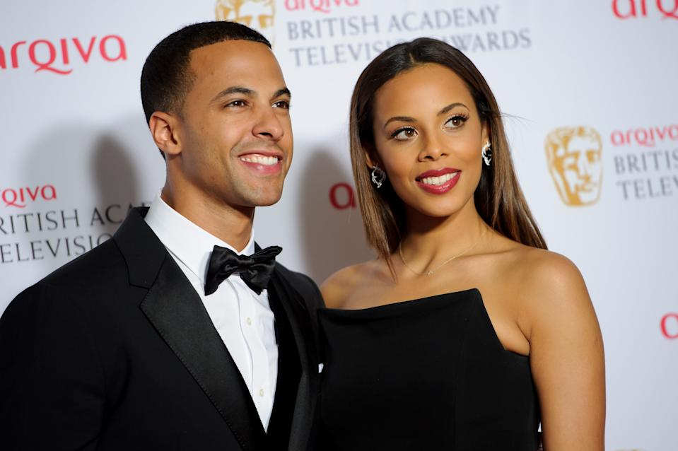 Rochelle Wiseman and Marvin Humes pose for photographers in the winners room at the British Academy Television Awards at a central London venue, Sunday, May 18, 2014. (Photo by Jonathan Short/Invision/AP)