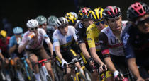 Slovenia's Tadej Pogacar, wearing the overall leader's yellow jersey, follows Richard Carapaz of Ecuador, right, Poland's Rafal Majka, second right, and is followed by Belgium's Wout Van Aert, Denmark's Jonas Vingegaard, wearing the best young rider's white jersey, and Australia's Ben O'Connor, drinking, as they climb during the eighteenth stage of the Tour de France cycling race over 129.7 kilometers (80.6 miles) with start in Pau and finish in Luz Ardiden, France,Thursday, July 15, 2021. (AP Photo/Christophe Ena)