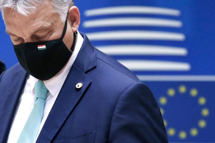 "FILE- In this Saturday, July 18, 2020, file photo, Hungary's Prime Minister Viktor Orban wears a protective face mask as he arrives for a round table meeting at an EU summit in Brussels. Hungary's prime minister says that his country won a ""very important battle"" at the European Union summit this week, where national leaders of the 27-member bloc decided an seven-year budget and economic recovery package to counter the effects of the coronavirus pandemic. (Francois Lenoir, Pool Photo via AP. File)"