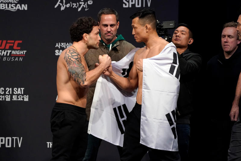 BUSAN, SOUTH KOREA - DECEMBER 20: (L-R) Frankie Edgar and Chan Sung Jung of South Korea face off during the UFC fight night weigh-in at Sajik Arena on December 20, 2019 in Busan, South Korea. (Photo by Jeff Bottari/Zuffa LLC via Getty Images)