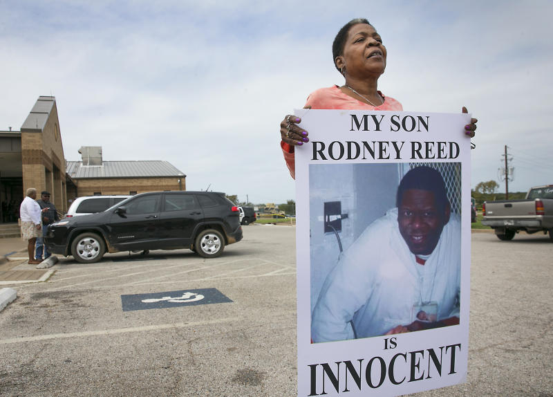 Sandra Reed, the mother of death row inmate Rodney Reed, shows her continued support of her son by carrying this placard around the parking lot during a break in a hearing in Bastrop County District Court on Tuesday, October 10. 2017. | Ralph Barrera—AP