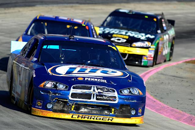 MARTINSVILLE, VA - OCTOBER 30: Brad Keselowski, driver of the #2 Miller Lite Dodge, leadsMartin Truex Jr., driver of the #56 NAPA Auto Parts Toyota, and Clint Bowyer, driver of the #33 American Ethanol/ Cheerios Chevrolet, during the NASCAR Sprint Cup Series TUMS Fast Relief 500 at Martinsville Speedway on October 30, 2011 in Martinsville, Virginia. (Photo by John Harrelson/Getty Images for NASCAR)