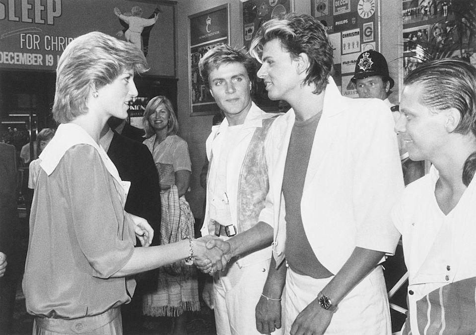 <p>The members of Duran Duran dressed like their typical '80s selves to meet Princess Diana at the Prince's Trust Rock Gala. Simon Le Bon (center) opted for white pants, a crew neck t-shirt, and a white blazer—with the sleeves rolled up, of course. </p>