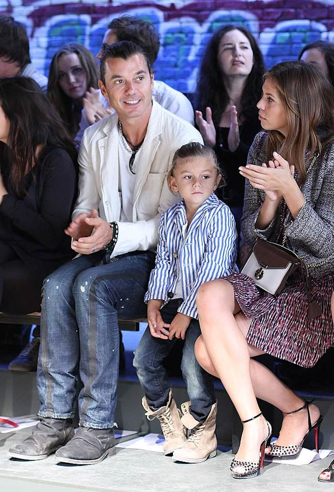 "Gavin Rossdale attended the Edun show with his oldest son Kingston, who rocked slicked back hair, jeans, and a blazer just like his dad. The Edun line, which was started by Ali Hewson and her husband, U2 singer Bono, uses organic and sustainable materials whenever possible. In addition, 15 percent of the collection is made in Africa. Jerritt Clark/<a href=""http://www.wireimage.com"" target=""new"">WireImage.com</a> - September 11, 2010"