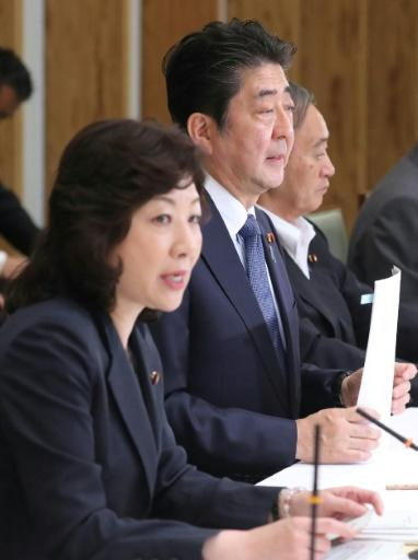 Japan's Prime Minister Shinzo Abe and women's empowerment minister Seiko Noda (left) meet with cabinet members on the anti-harassment initiative