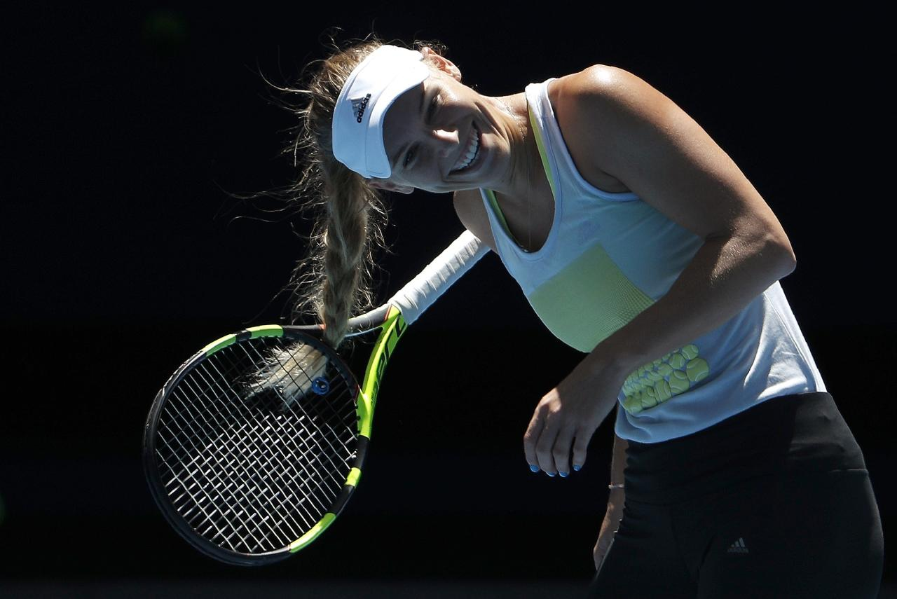 Tennis - Australian Open - Melbourne, Australia, January 14, 2018. Caroline Wozniacki of Denmark laughs as her hair is caught in the racquet during a practice session before the Australian Open tennis tournament. REUTERS/Edgar Su    TPX IMAGES OF THE DAY