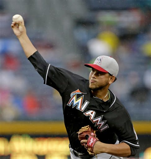 Miami Marlins starting pitcher Henderson Alvarez throws in the first inning of a baseball game against the Atlanta Braves, Thursday, July 4, 2013, in Atlanta. (AP Photo/David Goldman)