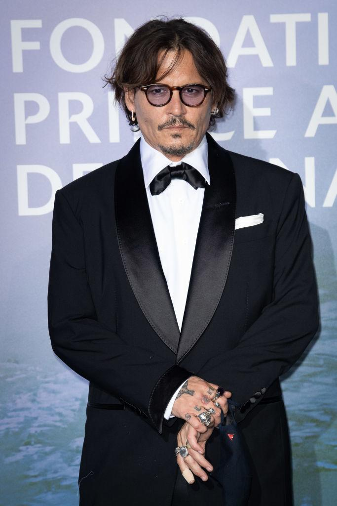 """2020 was not kind to <a href=""""https://ca.search.yahoo.com/search?p=JohnnyDepp&fr=fp-tts&fr2"""" data-ylk=""""slk:Johnny Depp"""" class=""""link rapid-noclick-resp"""">Johnny Depp</a>. Although the actor has been plagued by allegations of domestic abuse against ex-wife Amber Heard for years, new details of their tumultuous relationship resurfaced during a recent lawsuit against <em>The Sun</em>, a British tabloid. Depp sued the publication after a 2018 article referred to the """"Pirates of the Caribbean"""" star as a """"wife beater."""" However, in November a judge ruled in favour of The Sun after deeming there was """"overwhelming evidence"""" of assault against Heard. Following the ruling, Depp announced he was leaving the Harry Potter """"Fantastic Beasts"""" spin-off franchise after he was asked by Warner Brothers to resign."""