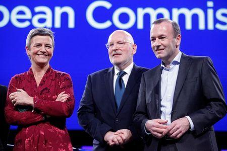 Margrethe Vestager of the Alliance of Liberals and Democrats for Europe (ALDE), Frans Timmermans of the Party of European Socialists (PES) and Manfred Weber of the European People's Party (EPP) pose for a group photo before a debate in the European Parliament, ahead of the May 23-26 elections for EU lawmakers, in Brussels, Belgium May 15, 2019.  REUTERS/Francois Walschaerts