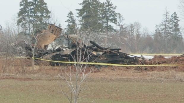Piles of rubble remained on Sunday afternoon where the house once stood.