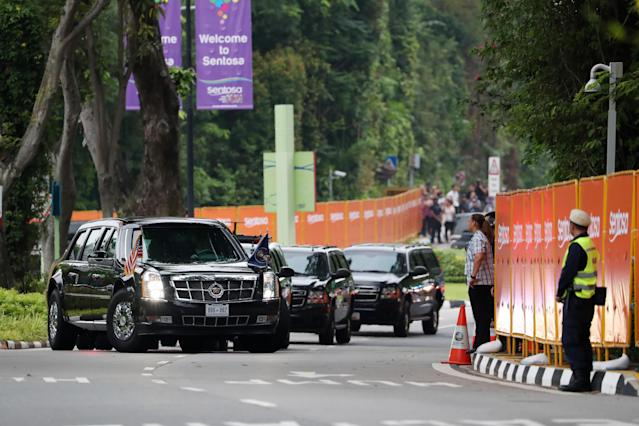 <p>U.S. President Donald Trump's motorcade arrives at the Capella Hotel in Singapore, on Tuesday, June 12, 2018. President Donald Trump plans to shake hands and have lunch with North Korean leader Kim Jong Un, kicking off a historic summit on Tuesday between two adversaries that only last year had seemed at the brink of nuclear war. Photographer: SeongJoon Cho/Bloomberg </p>