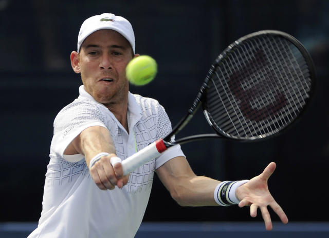 Dudi Sela, of Israel, returns a shot to John Isner, of the United States, in the first set of the Atlanta Open tennis tournament final on Sunday, July 27, 2014, in Atlanta. Isner won 6-3, 6-4. (AP Photo/David Tulis)