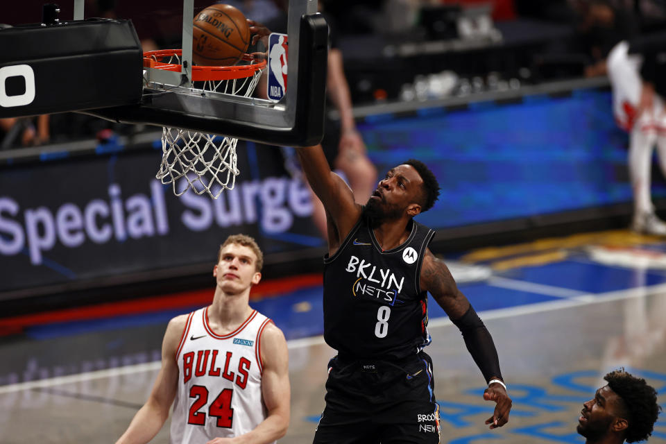 Brooklyn Nets forward Jeff Green (8) dunks the ball over Chicago Bulls forward Lauri Markkanen during the second half of an NBA basketball game Saturday, May 15, 2021, in New York. (AP Photo/Adam Hunger)
