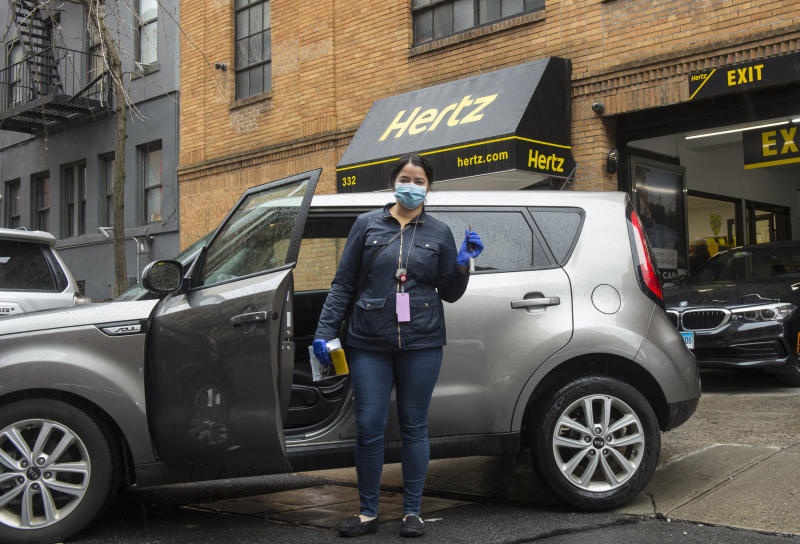 """IMAGE DISTRIBUTED FOR HERTZ - Lisette Marchand, a resident coordinator at Montefiore Hospital, picks up her free rental from Hertzin New York City, Saturday, March 28, 2020.Hertz is providing vehicles to New York City healthcare workers to help them get to and from work so they can continue providing critical care to the community during the coronavirus (COVID-19) pandemic. """"It gives all of us at Hertz a sense of purpose and pride to lend our support as much as we can during this very difficult time,"""" said Kathryn Marinello, Hertz President and CEO.(Diane Bondareff/AP Images for Hertz)"""