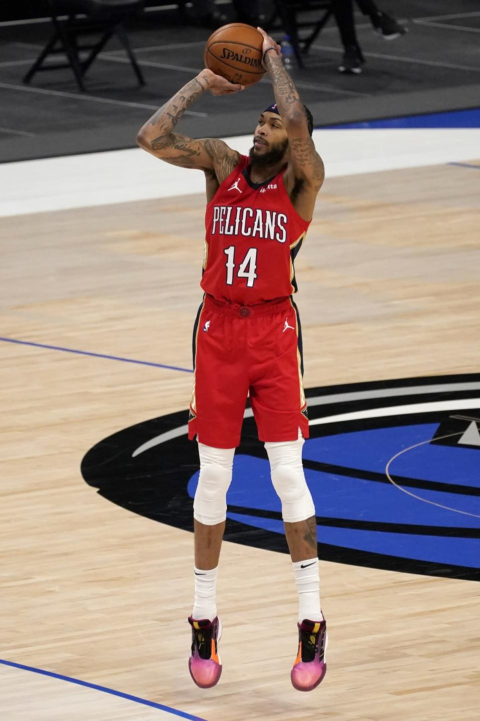New Orleans Pelicans' Brandon Ingram (14) attempts a 3-point basket during the second half of the team's NBA basketball game against the Dallas Mavericks in Dallas, Friday, Feb. 12, 2021. (AP Photo/Tony Gutierrez)