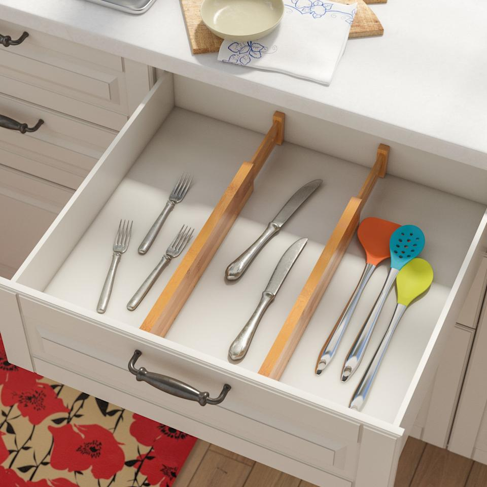 """<p>This <a href=""""https://www.popsugar.com/buy/Adjustable-Two-Piece-Drawer-Organizer-Set-582073?p_name=Adjustable%20Two%20Piece%20Drawer%20Organizer%20Set&retailer=wayfair.com&pid=582073&price=20&evar1=casa%3Aus&evar9=45654164&evar98=https%3A%2F%2Fwww.popsugar.com%2Fphoto-gallery%2F45654164%2Fimage%2F47574141%2FAdjustable-Two-Piece-Drawer-Organizer-Set&list1=shopping%2Corganization%2Chome%20organization%2Cbest%20of%202020&prop13=api&pdata=1"""" rel=""""nofollow"""" data-shoppable-link=""""1"""" target=""""_blank"""" class=""""ga-track"""" data-ga-category=""""Related"""" data-ga-label=""""https://www.wayfair.com/storage-organization/pdp/rebrilliant-adjustable-2-piece-drawer-organizer-set-rebr2299.html"""" data-ga-action=""""In-Line Links"""">Adjustable Two Piece Drawer Organizer Set</a> ($20) allows you to fit them perfectly into your space.</p>"""