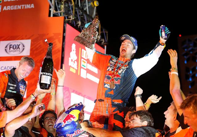 Dakar Rally - 2018 Peru-Bolivia-Argentina Dakar rally - 40th Dakar Edition - January 20, 2018. Matthias Walkner of Austria celebrates with the Dakar's trophy after winning in the bikes category. REUTERS/Andres Stapff